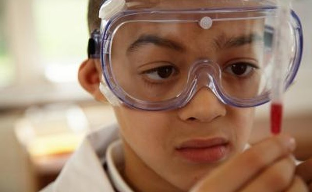 Young boy wearing safety goggles