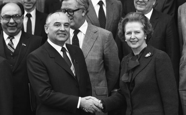 Soviet Politburo member Mikhail Gorbachev shakes hands with British Prime Minister Margaret Thatcher at Chequers on December 16, 1984.