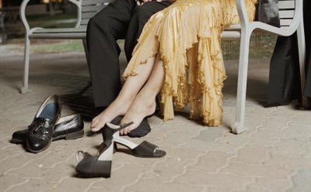 Couple on park bench with removed shoes