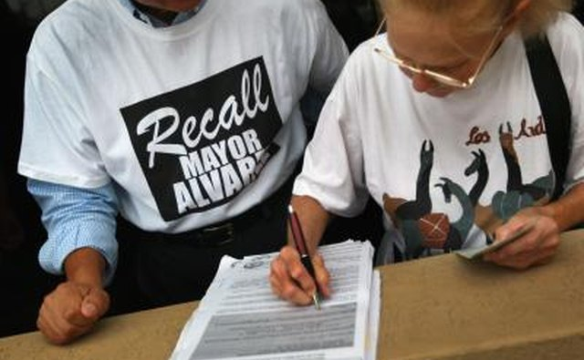 Marie Bond signs a petition to recall Miami-Dade County Mayor Carlos Alvarez