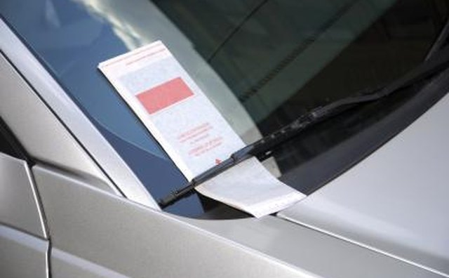 Leave what looks to be a parking ticket on her windshield.