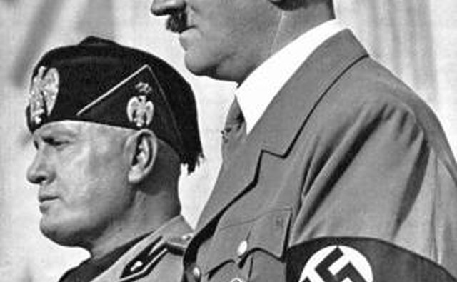 Adolf Hitler can be seen wearing his own Iron Cross, awarded during World War I.