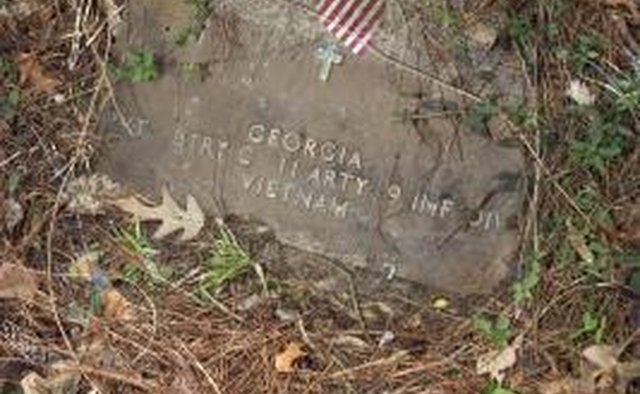 Some older cemeteries create concrete lips over flat markers for flags.