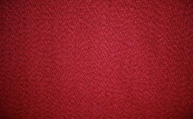 The color red looks luxurious in furniture upholstery and carpeting