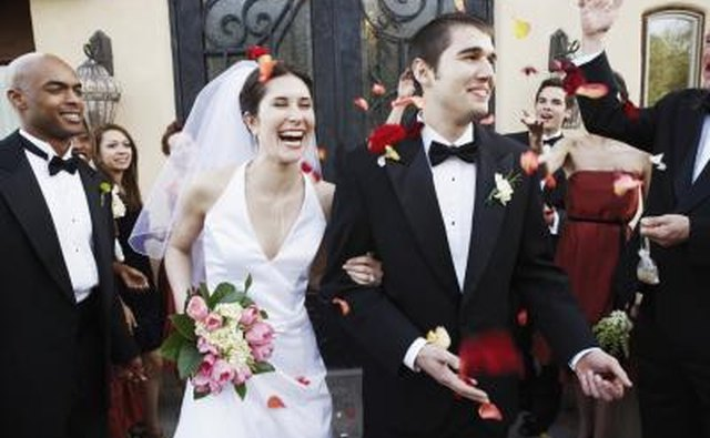 A bride and groom exit a church as husband and wife.