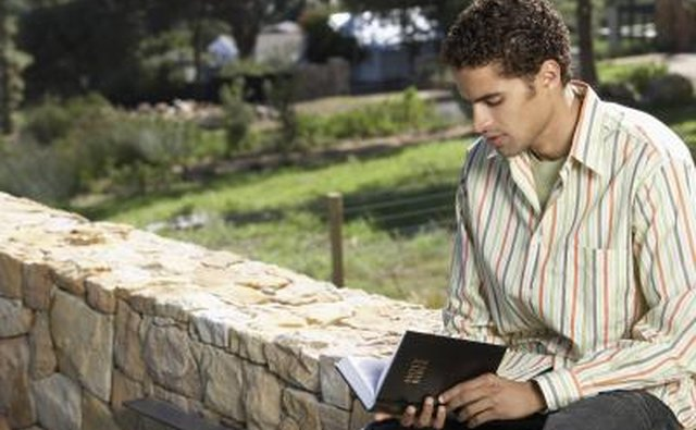 man reading the Bible outside