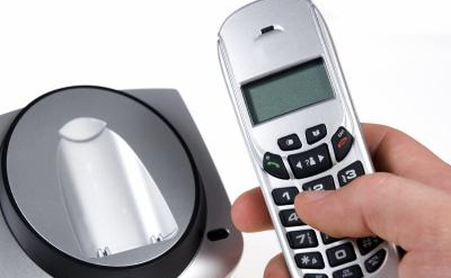 Close up of a cordless phone in a hand.