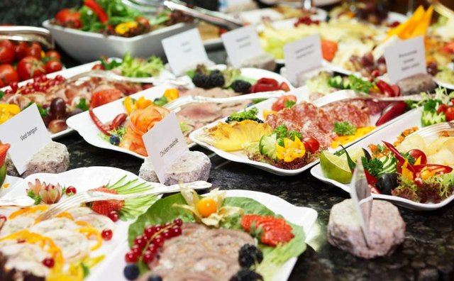 A full buffet with meat, cheese and fish