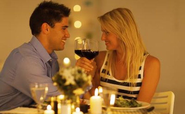 Couple toast wine at dinner table