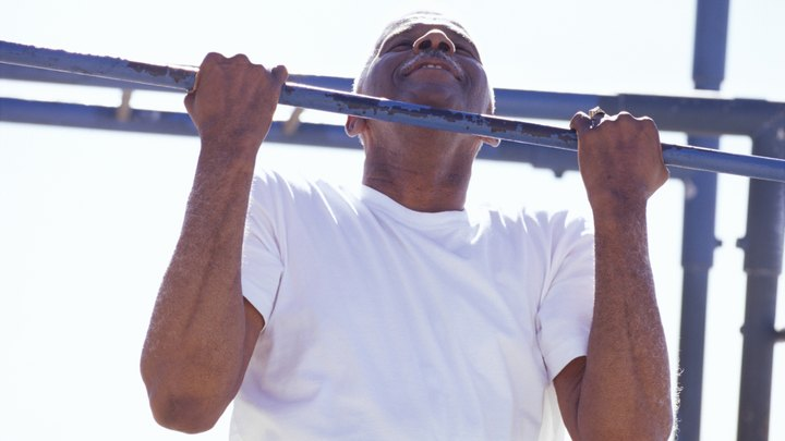 A pull-up is an intense back-building exercise. It is a bodyweight movement that uses vertical pulling to strengthen your arms and back. Changing a hand position in a pull-up offers variety to training, different muscle focus and a reduction in injuries. By frequently changing the way you perform pull-ups, you protect your shoulders from repetitive injuries. Your muscles will continue to respond to the changing stimulus with improvements in strength and tone. Performed safely and with proper form a pull-up will remain part of your workout routine for years to come.