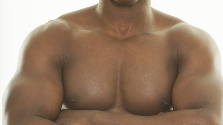 Build up chest muscles with targeted workouts on a consistent basis.