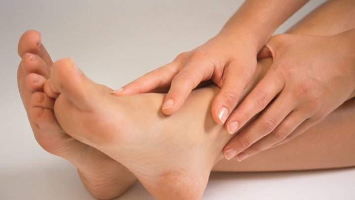 Tingling feet can be bothersome as you try to exercise and move about in daily life. Experiencing an odd, tingling sensation in your feet can make it difficult to get motivated to work out. The tingling causes can vary from simple issues such as tight shoes to permanent nerve damage. Stretching different areas of your body -- not just your feet -- can help relieve the tingling. If you have unexplained, prolonged tingling in your feet, see a doctor to rule out any serious issues.