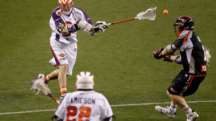 "Lacrosse resembles sports such as soccer and hockey, with two teams that move up and down a field trying to propel an object into a net. In lacrosse, players carry a long stick, called a ""crosse,"" with netting on the end that allows them to carry a small rubber ball. Players can also pass the ball to a teammate, scoop up a loose ball or direct the ball at the net. The object of the game is to shoot the ball into the net. With the exception of Major League Lacrosse, a goal in lacrosse is always worth one point."