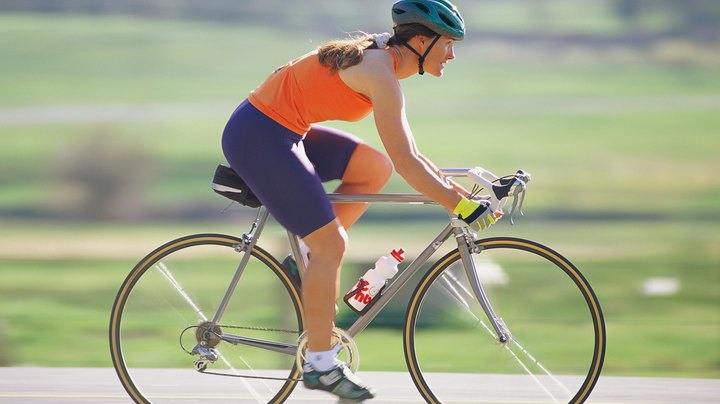 Aerobic exercises such as bicycling and running long distances continually supply oxygen to your body. They're different than stop-and-start anaerobic exercises such as weight training and sprinting short distances that leave you breathless because they require so much short-term energy that your body develops an oxygen deficit. Yoga isn't either an aerobic or anaerobic exercise. It's a physically and mentally relaxing activity that stretches muscles. Aerobic exercises improve physical fitness more than yoga, raise heart rates more and burn far more calories.