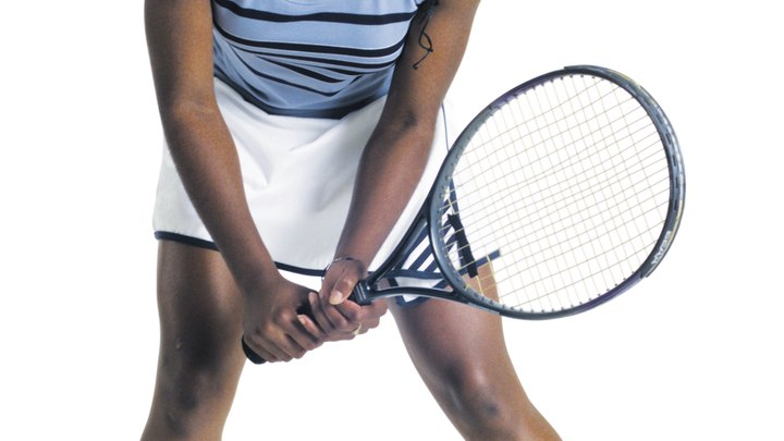 If your butt is getting a bit flabby, it may be time to pick up tennis. Tennis is an excellent way to tone the muscles of you rear -- called your gluteals -- because the game keeps your muscles constantly engaged. As you move to meet the ball, stop and change directions, you will begin to feel the tension in your tush. Playing tennis on a consistent basis will give your butt a workout, leading to a lean and muscular look you can be proud of.