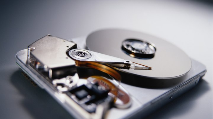 If you're planning to purchase a new computer for an employee or upgrade existing equipment, you need to estimate the amount of disk space required for the 64-bit version of Windows 7 Enterprise and the amount of space required for program files, system files and user data files. You can split a Windows installation between two hard disk drives, for example, if you want to run Windows 7 from a solid-state disk drive and store user files on a traditional hard drive.