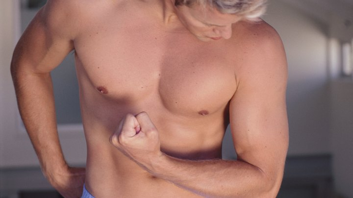 In the vast majority of cases, pointy, flabby pecs are a result of excess body weight, genetics or some combination of the two. In rare cases, they can result from gynecomastia, a condition characterized by enlarged breasts in men. Although targeted weight-loss is impossible, you can still perform strength-training exercises to tone your pecs without bulking them up. Meanwhile, you can flatten the appearance of your chest by eating more healthily and engaging in more cardiovascular exercise to burn body fat that could be causing your prominent pecs.