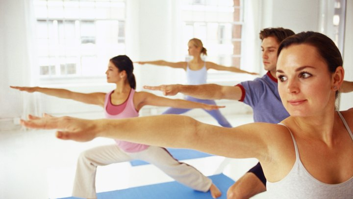 If you admit you're a busy, sleep deprived, stressed-out student, yoga can become your new best friend. Yoga styles available for you to choose from range from Iyengar, with a focus on relaxation, to physically rigorous styles such as power and Bikram yoga. Any type of yoga can fit into a student schedule, as studios tend to offer morning, afternoon and evening classes. Adding yoga to your routine can be as simple as grabbing your favorite pair of sweatpants and a mat and heading to the nearest studio.
