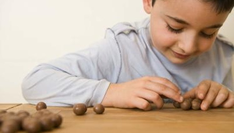 Make counting fun by setting up small games for your child.
