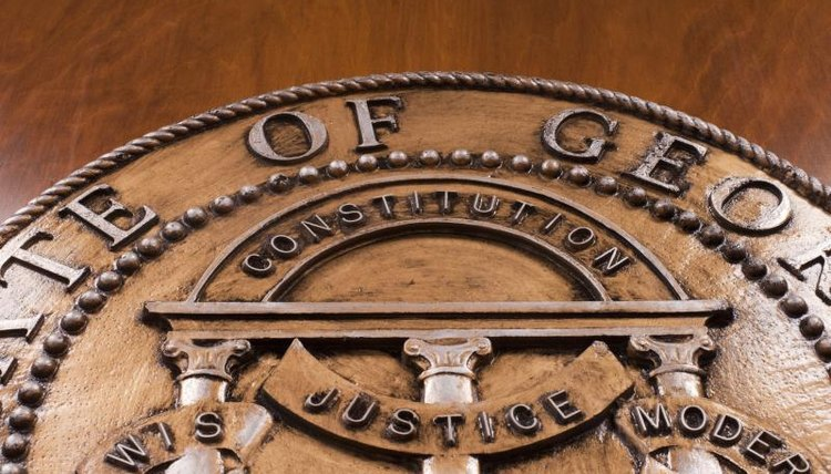 A close-up of a wood carving of a court's official seal.
