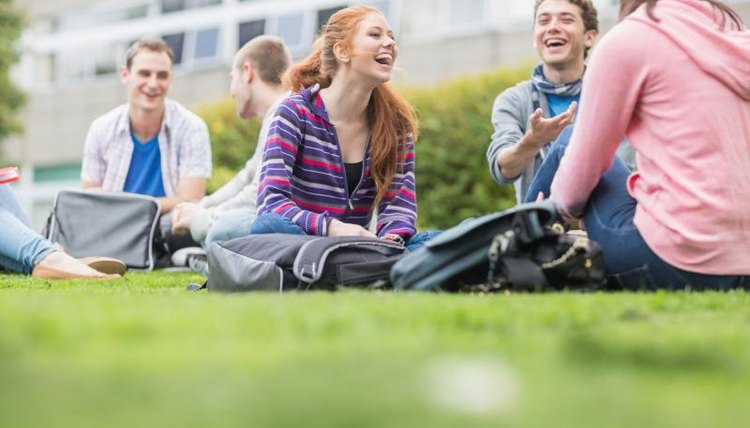 College students sitting on a grass