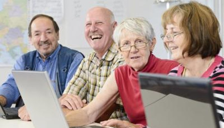 Seniors learning in a computer class