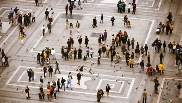 An elevated view of people walking in a plaza.