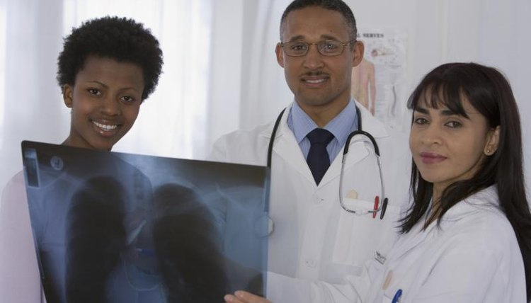 Group of doctors looking at an X-ray of lungs.