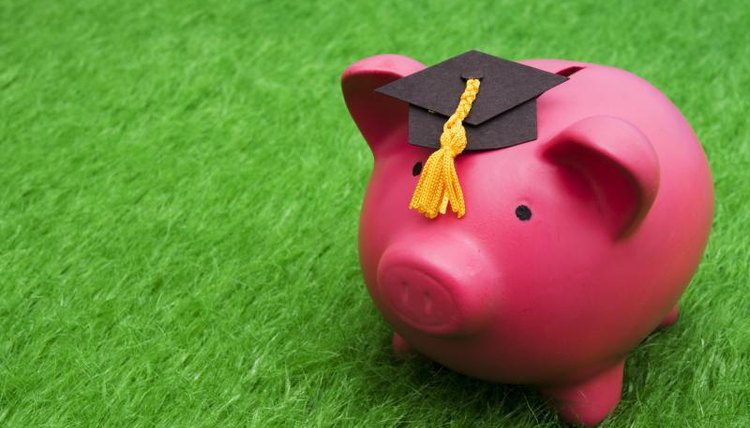 Piggy bank with graduation cap on top of it.