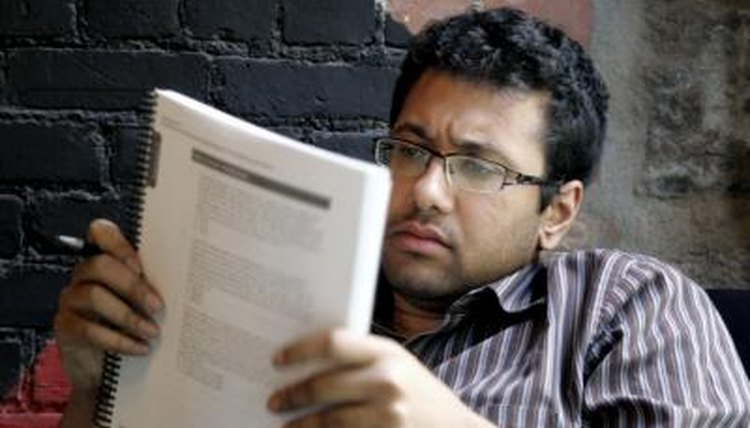 Image of a man reading a report.
