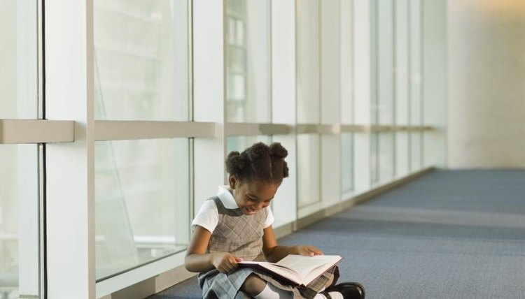 Young student reading in hallway