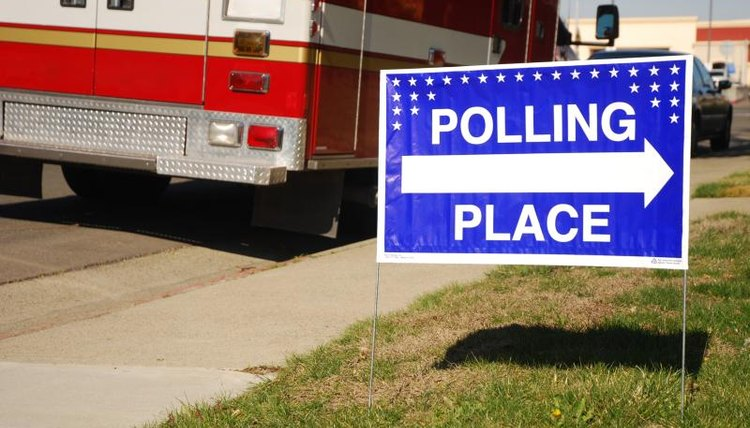 """Polling Place"" sign pointing to voting booth."