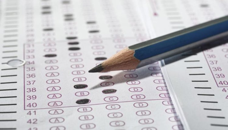 Close-up of pencil on top of scantron answer sheet.