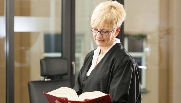 A female lawyer reading a legal reference books.