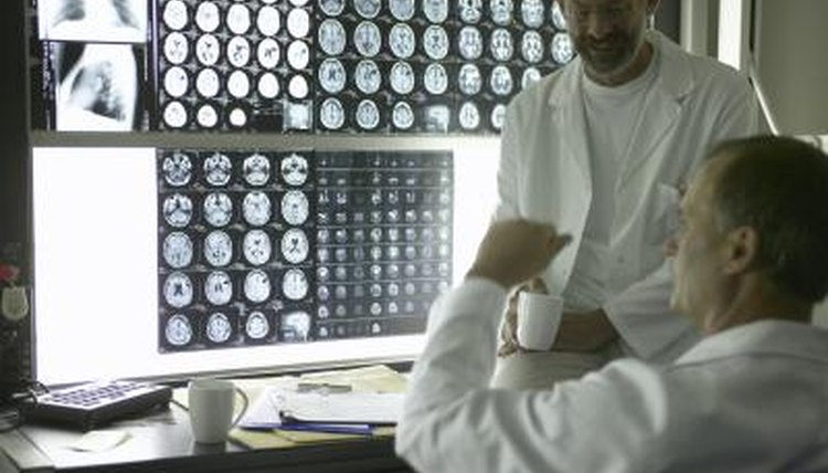 Two neuroscientists looking at MRI scans