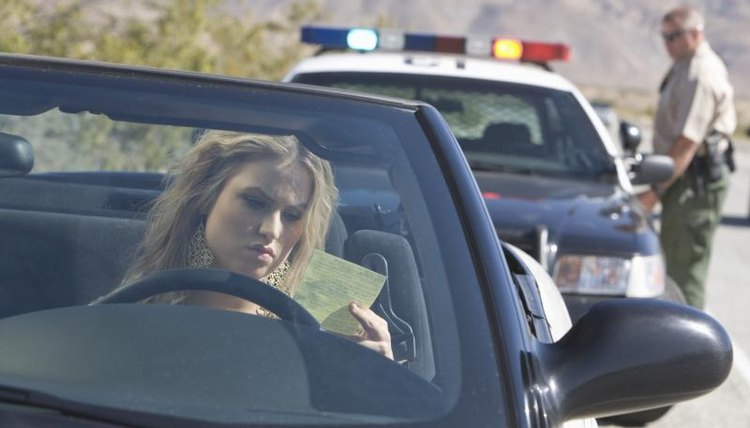 A woman, a traffic violation, an officer, her