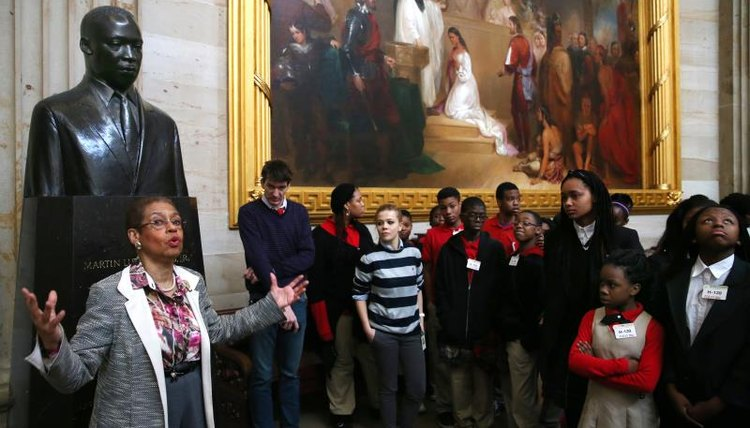 A group of school children touring an art museum.