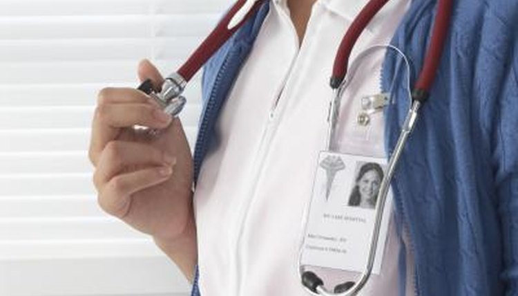 Close-up of identification card on doctor's blouse.