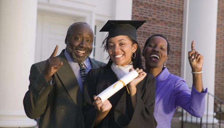 Parents posing next to a graduate student.