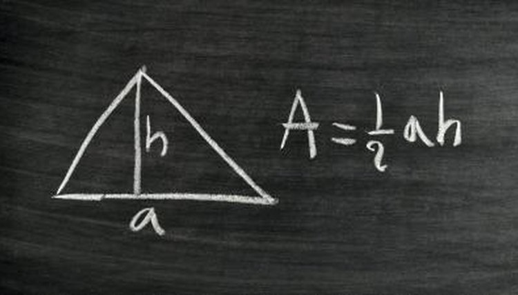 Triangle area formula written on chalkboard.