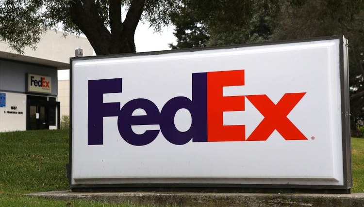 Close-up of large FedEx sign.