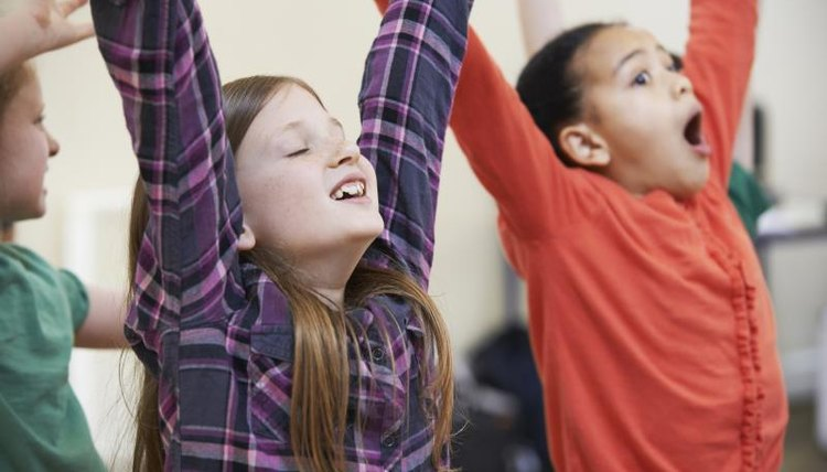 Movement warm-ups are one of several types of drama games that grade school students enjoy.