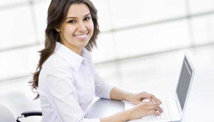 Young woman typing on laptop