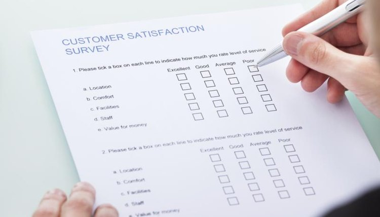 A woman is filling out a survey.