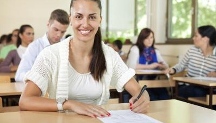 High school student taking test in classroom