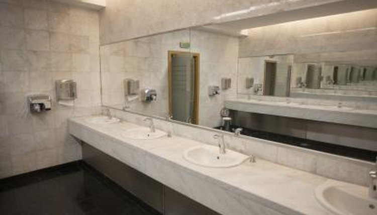 Row of sinks and mirror in a restroom.