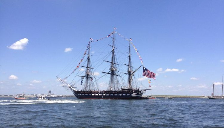 A wide shot of the USS Constitution at sea.