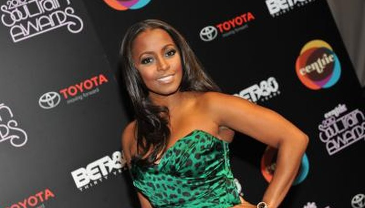 Keisha Knight Pulliam poses for a photograph at a benefit function.