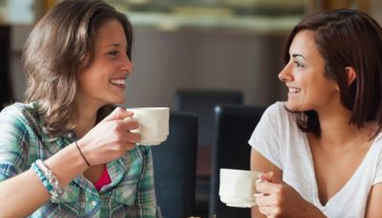 Friends having conversation over tea
