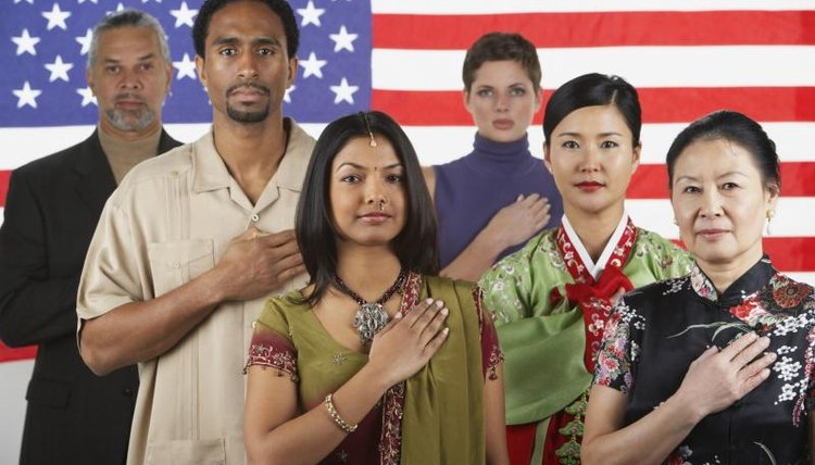 Multiethnic people, front, an American flag